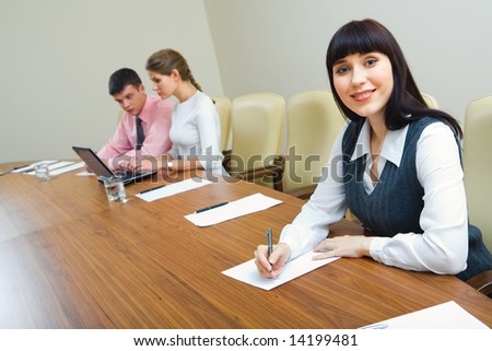 Portrait of specialist sitting at the table at business briefing