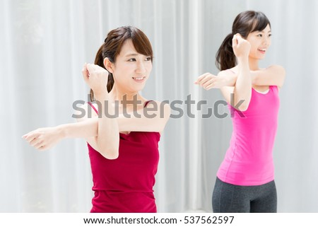 portrait of sporty asian women exercising
