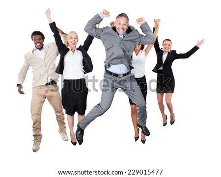 Portrait of successful business team with arms raised standing over white background