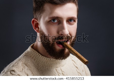 Portrait of suspicious bearded man with cigar