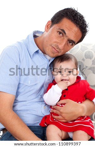 Portrait of sweet young baby with her father at home