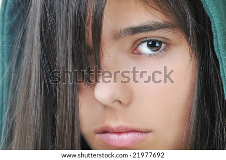 Portrait of Teenage Girl with hair covering half of her face