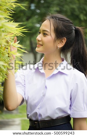 Portrait of thai high school student uniform teen beautiful girl happy and relax