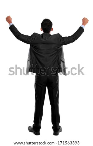 portrait of the back of business man with arms raised in success