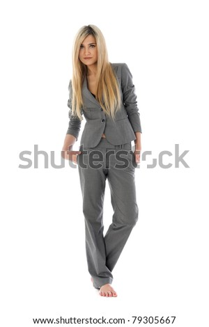 Portrait of the beautiful blonde in a grey costume. Isolated image