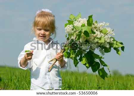 Portrait of the beautiful girl and flowers on rest