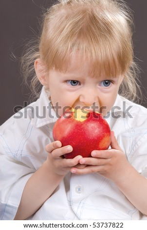 Portrait of the beautiful girl with an apple