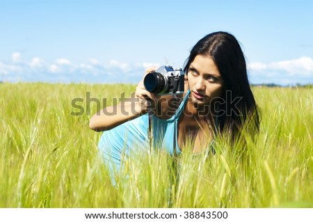 Portrait of the beautiful woman with a camera