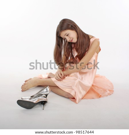 Portrait of the nice teen girl in pink clothes with shoes whose legs ...