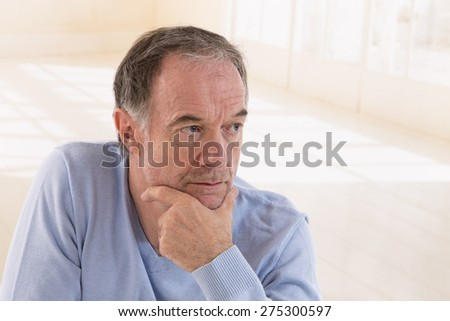 portrait of thoughtful middle aged man looking away