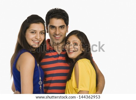 Portrait of three friends smiling