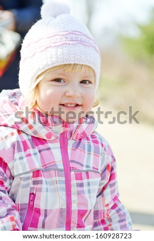 portrait of toddler girl wearing winter clothing