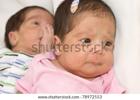 Portrait of twin babies boy and girl