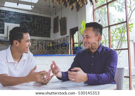 portrait of two asian Business people meeting in a coffee shop