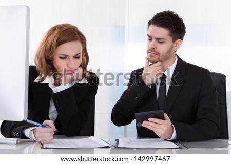 Portrait of two business colleagues at office working together