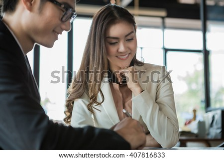 portrait of two business people discussing new project in coffee shop