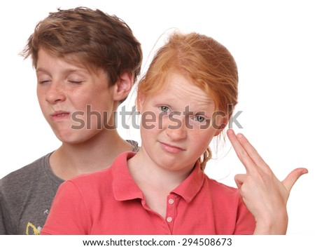 Portrait of two funny grimacing teenagers
