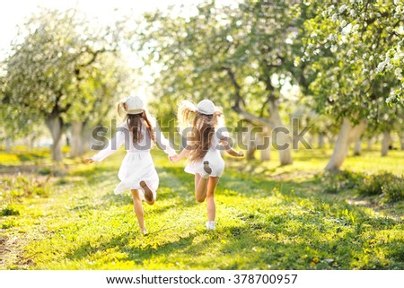 portrait of two girls of girlfriends on a summer nature
