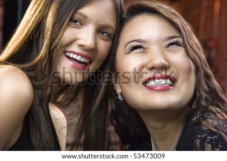 Portrait of two pretty smiling young women.