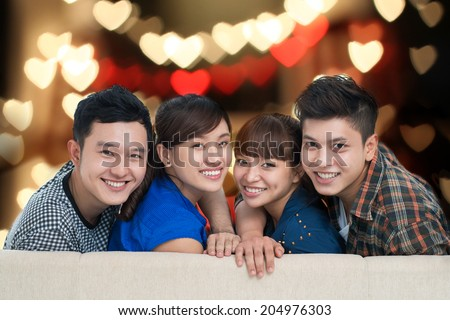 Portrait of two Vietnamese couples having double date