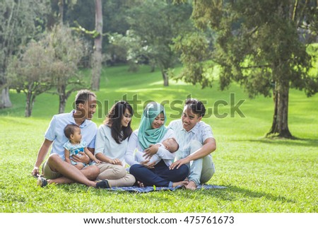 portrait of two young asian Family in the park enjoying spring together