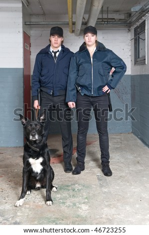Portrait of two young police officers of a k9 squad
