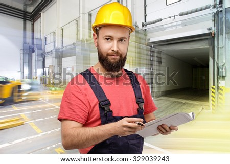 Portrait of Warehouse worker in logistic center