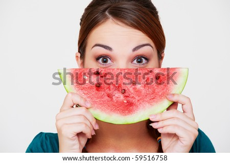 portrait of woman with slice of watermelon