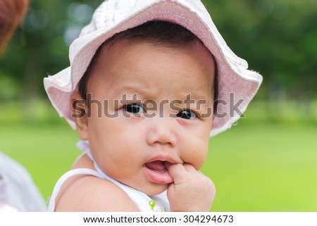 Portrait of wonder baby with nature background at park.