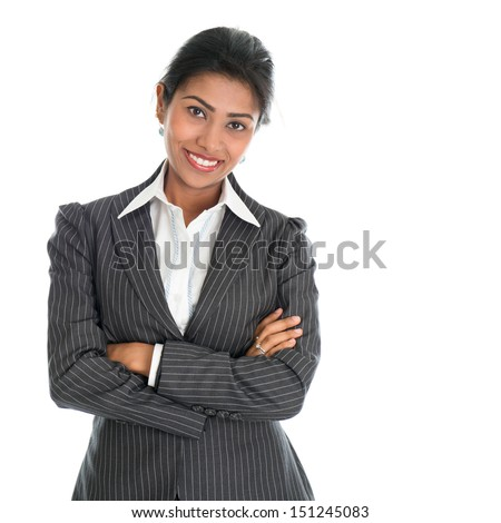 Portrait of young African American businesswoman in business suit, isolated over white background. Mixed race Asian Indian and African American model.