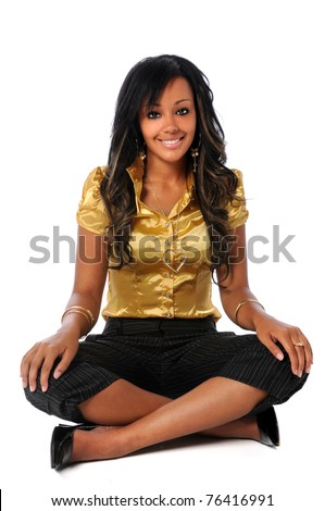 Portrait of young African American woman sitting isolated over white background