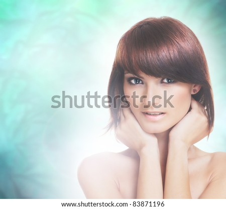 Portrait of young and healthy brunette isolated over abstract background