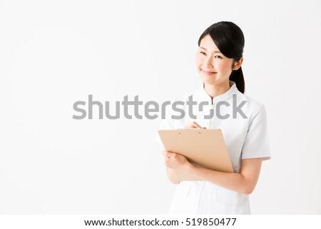 Asian nurse in shower