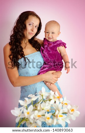 portrait of young beautiful mother and her baby daughter