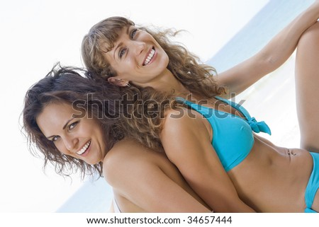 Portrait of young beautiful woman having good time in summer environment
