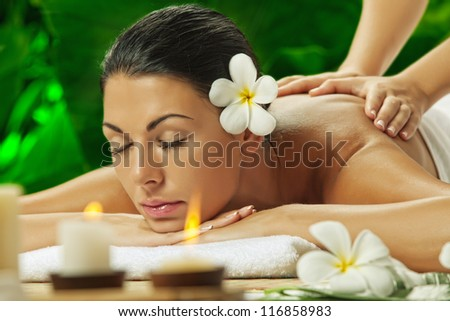 portrait of young beautiful woman in spa environment.