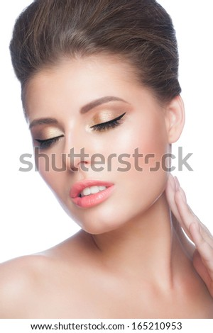 Portrait of young beautiful woman with stylish gold makeup, isolated on white background