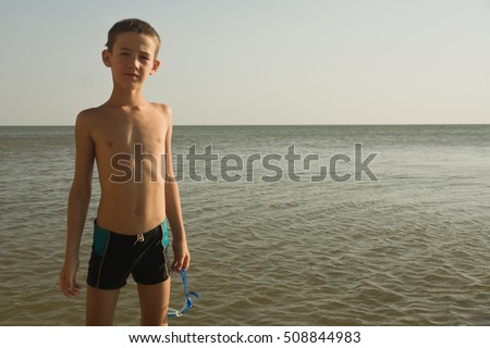 Portrait of young boy kid child at sea. Summer holidays vacation