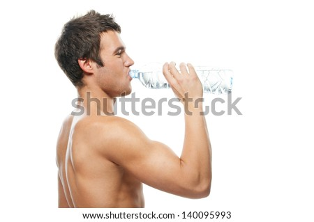 Portrait of young brunette man drinking water against white background.