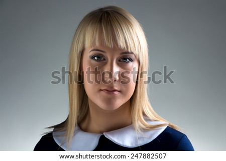 Portrait of young business woman on gray background