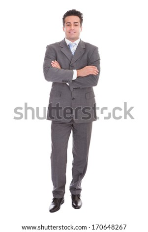 Portrait Of Young Businessman With Hands In Pocket