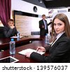 Portrait of young businesswoman in business training with her colleagues - stock photo