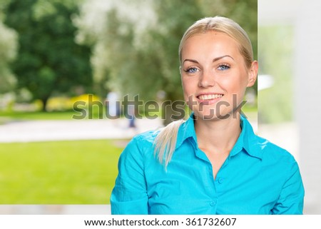 Portrait of young cheerful smiling woman