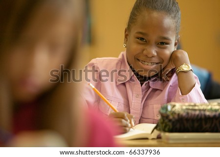 Portrait of young girl working in classroom