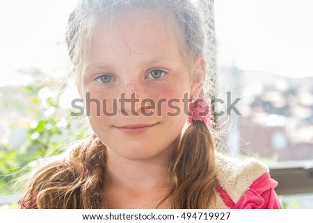 portrait of young happy child girl on natural background