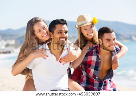 Portrait of young happy couples in love on romantic summer holidays vacation