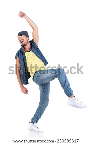 Portrait of young happy stylish dancer hip hop on the grey background.