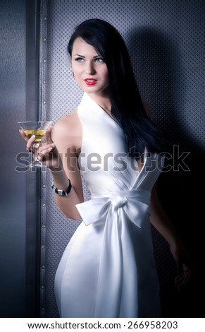 Portrait of young happyl beautiful woman with glass of wine