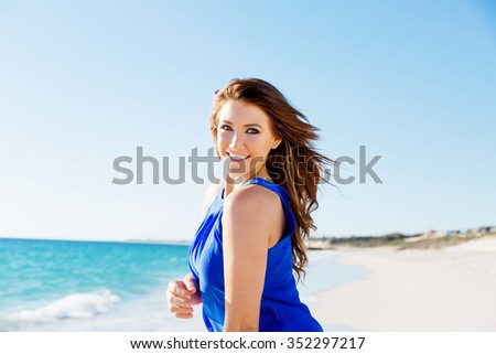 Portrait of young pretty woman on summer day on the beach