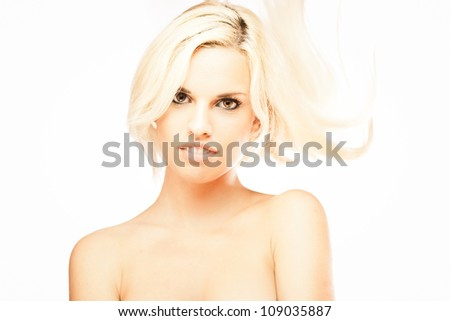 Portrait of young sexy blond girl isolated on white